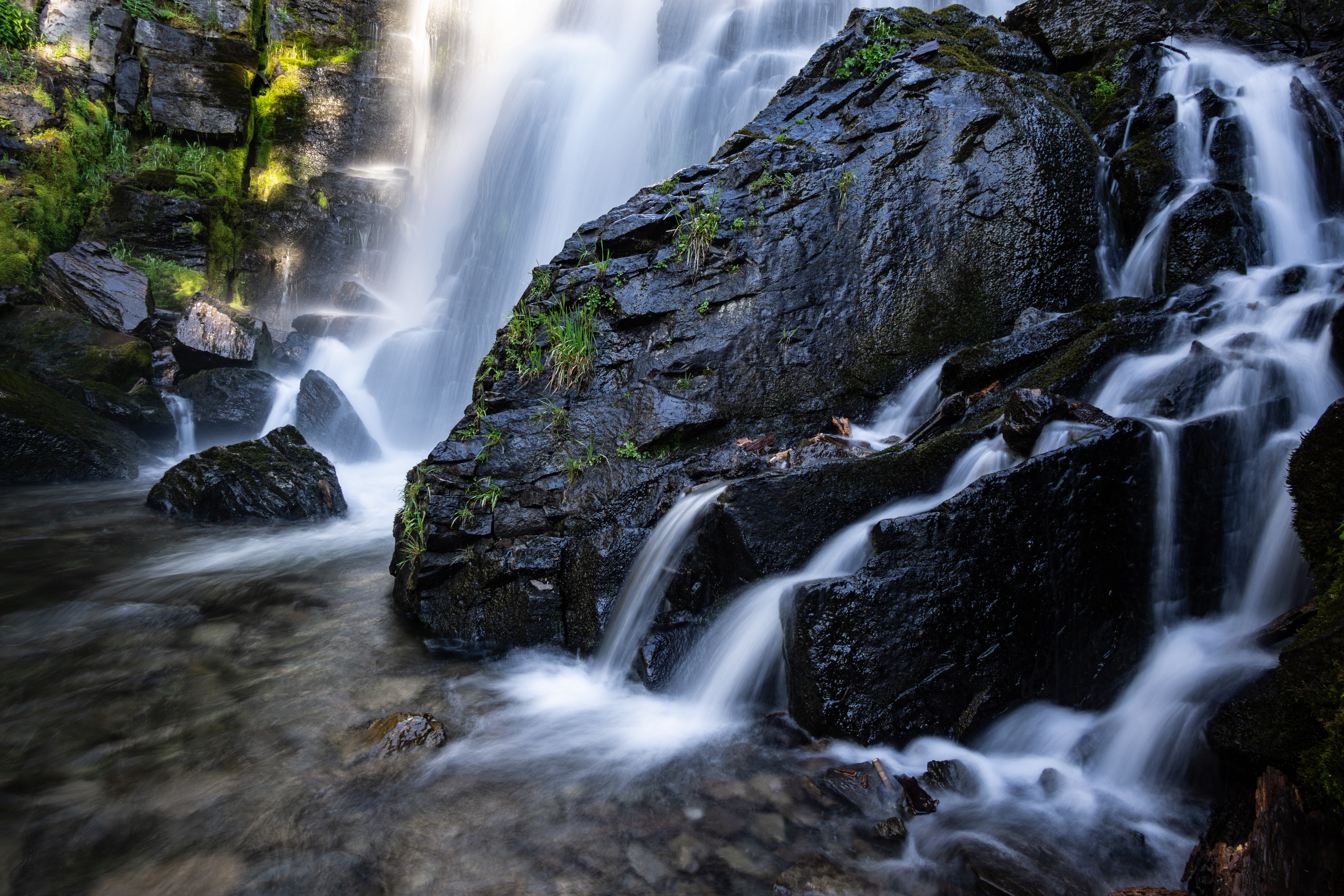 Long exposure of the lower portion of Kings Creek Falls. The water has a feathery, misty quality.